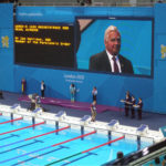 presenting swimming medals at Beijing 2008